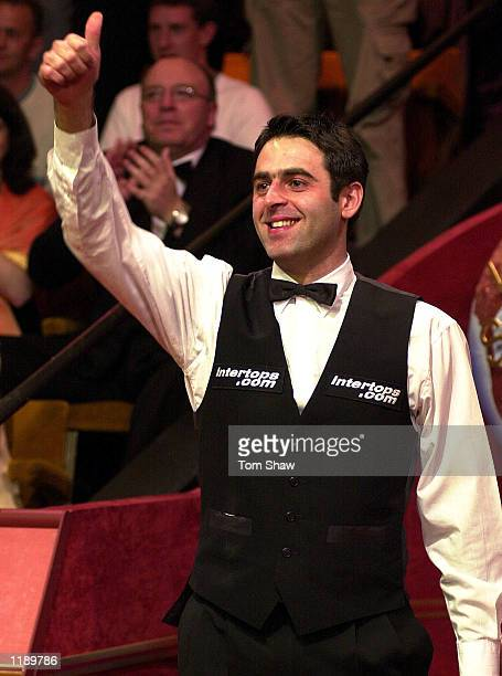 Ronnie O'sullivan of England acknowledges the crowd after beating John Higgins to win the final of the Embassy World Championship Snooker Finals at...