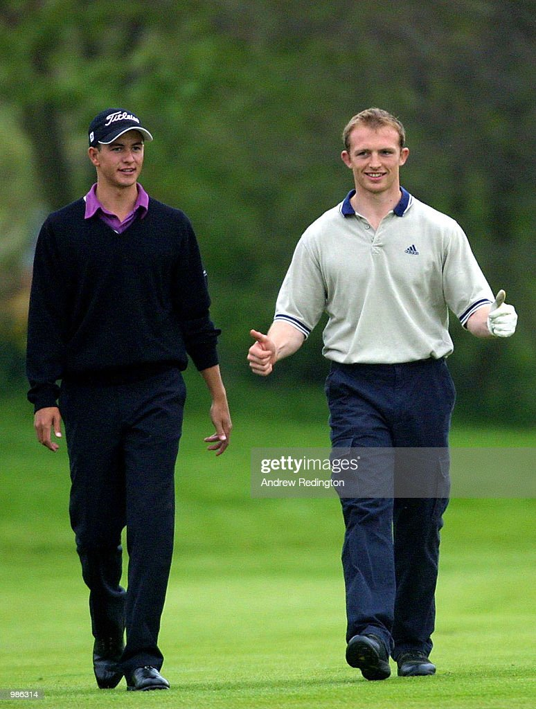 Rugby player Matt Dawson reacts to his shot as he walks down the fairway with partner Adam Scott of Australia during the Pro-Am event at the Benson & Hedges International Open held at the Belfry, Birmingham. Mandatory Credit: Andrew Redington/ALLSPORT
