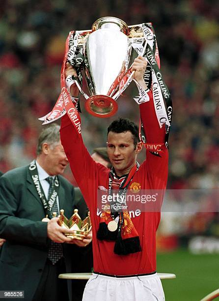 Ryan Giggs of Manchester United with the FA Carling Premiership trophy aftre the FA Carling Premiership match between Manchester United and Derby...