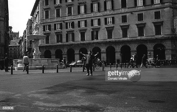 'Score' a Italian youth plays soccer in the streets of Genoa Italy Mandatory Credit Donald Miralle/ALLSPORT