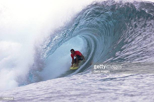 Shane Dorian of the USA was relegated to the losers round by wildcard Bruce Irons of the USA in the opening round heat during the Billabong Pro at...