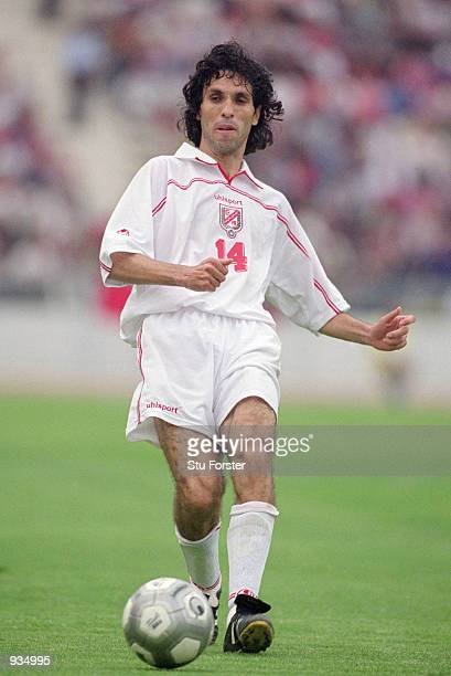 Sirajeddine Chihi of Tunisia in action during the 2002 World Cup Qualifier against Ivory Coast played at the El Menzah Stadium in Tunis Tunisia The...