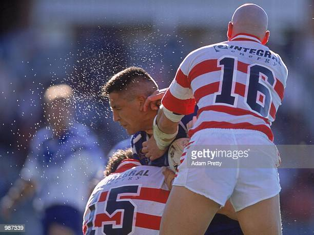 Steven Price for the Bulldogs is tackled by the Dragons defence during round 13 of the National Rugby League match played between the Bulldogs and...