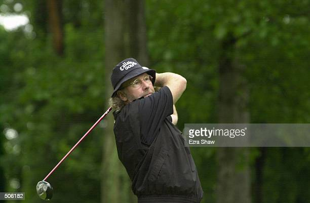Stewart Ginn of Australia hits a shot during the third round of the 2001 PGA Senior's Championship at Ridgewood C.C. In Paramus, New Jersey <DIGITAL...