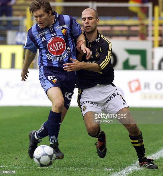Striker Johan Wallinder of Djurgarden left tries to go past swedish national team defender Teddy Lucic of AIK Solna in a round six game in the...