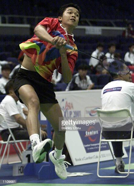 Taufik Hidayat of Indonesia executes a powerful smash during the game with Ronald Susilo of Singapore during the 2001 Asia Cup Badminton Championship...