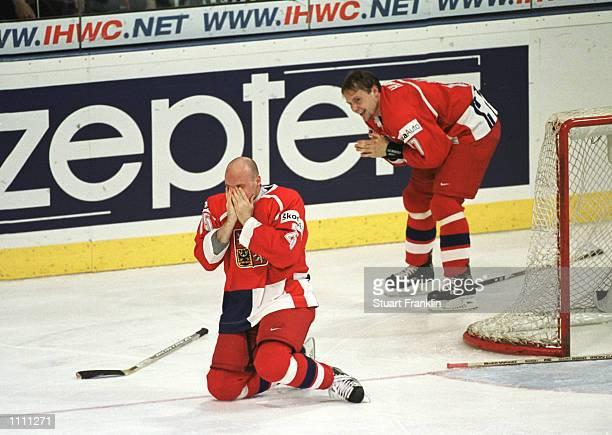 The Czechoslovakia Republic players Tomas Vlasak and Radek Martinev celebrate winning the World Ice Hockey Championships in Hanover, Germany....