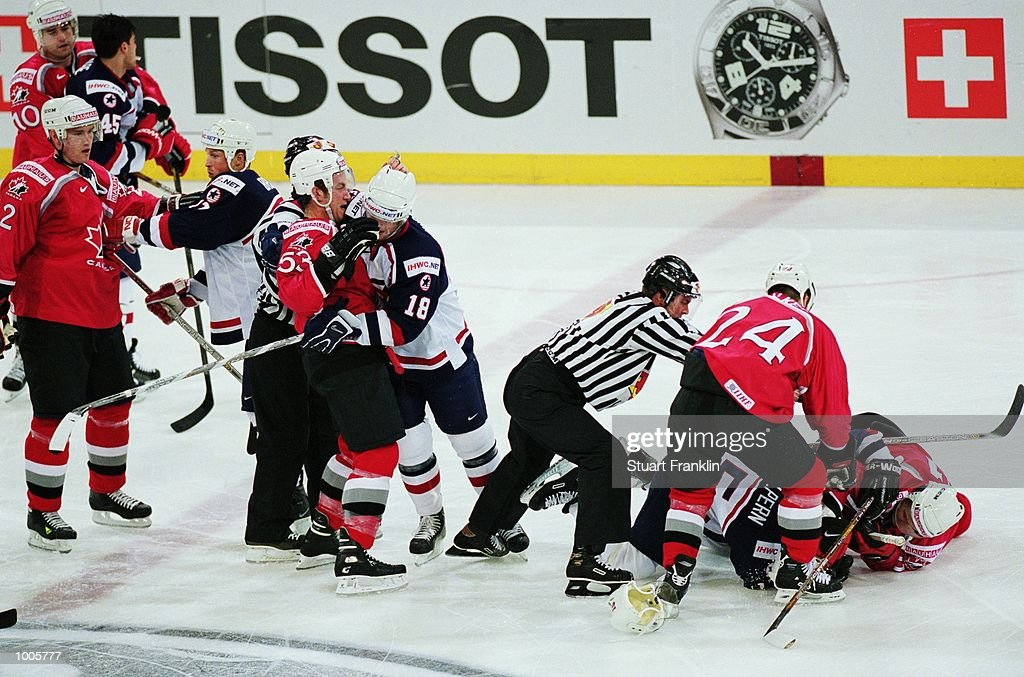 The Referee breaks up a fight during the IIHF World Ice Hockey Championship Quater-final match between USA and Canada held at the Preussag Arena in Hanover, Germany. \ Mandatory Credit: Stuart Franklin /Allsport