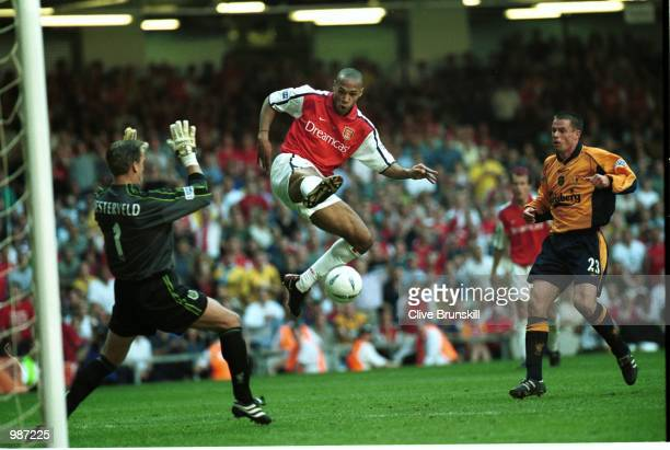 Thierry Henry of Arsenal goes in on goal during the AXA sponsored 2001 FA Cup Final between Arsenal v Liverpool at the Millennium Stadium Cardiff...