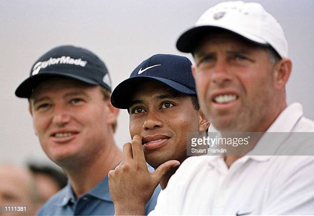 Tiger Woods of the USA with his caddie Steve Williams and Erne Els of South Africa during practice before the start of the Deutsche Bank SAP Open at...