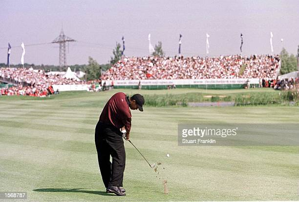 Tiger Woods of USA plays an iron off the fairway at the Deutsche Bank SAP Open at the StLeonRot Golf Club Germany Mandatory Credit Stuart...