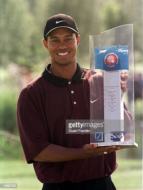 Tiger Woods of USA with the winners trophy at the Deutsche Bank SAP Open at the StLeonRot Golf Club Germany Mandatory Credit Stuart Franklin/ALLSPORT