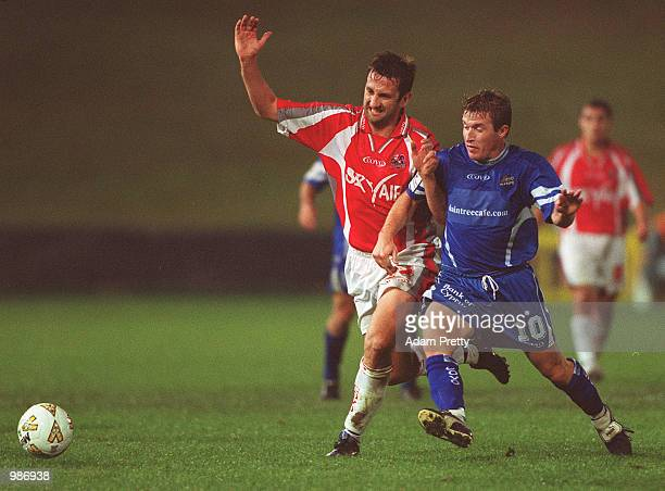 Troy Haplin of Sydney Olympic contests the ball with Steve Horvat of Melbourne Knights during the minor semi final at Parramatta Stadium Sydney...