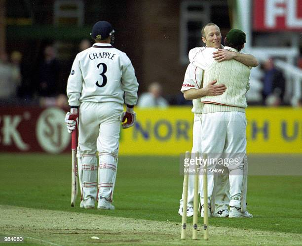 Vince Wells captain of Leicestershire celebrates with teammate neil Burns after dismissing Glenn Chapple of Lancashire for 8 in the Benson Hedges Cup...