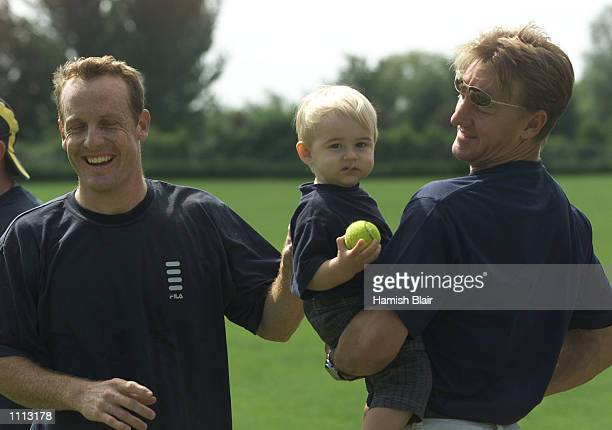 Wade Seccombe of Australia catches up with his Queensland team mate Andy Bichel and Bichel's son Keegan Bichel is in England playing County cricket...