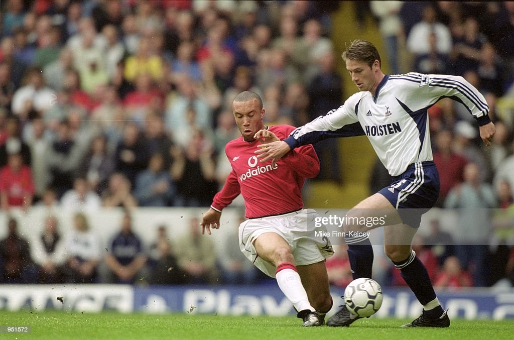 Willem Korsten of Tottenham Hotspur tries to take the ball past Mikael Silvestre of Manchester United during the FA Carling Premiership match played at White Hart Lane, in London. Tottenham Hotspur won the match 3-1. \ Mandatory Credit: MikeFinn-Kelcey /Allsport
