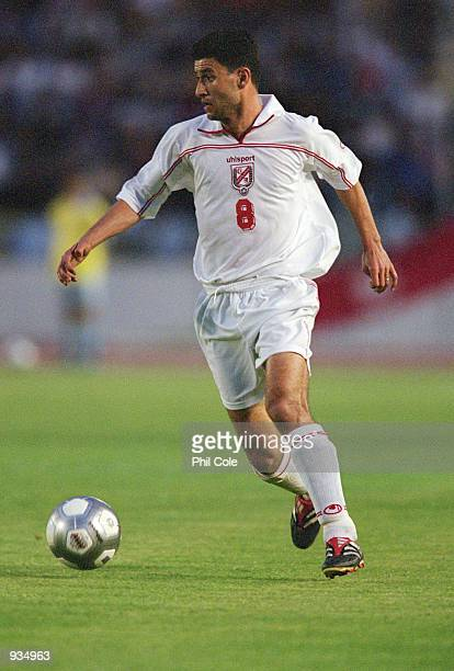 Zoubeir Baya of Tunisia in action during the 2002 World Cup Qualifier against Ivory Coast played at the El Menzah Stadium in Tunis Tunisia The match...