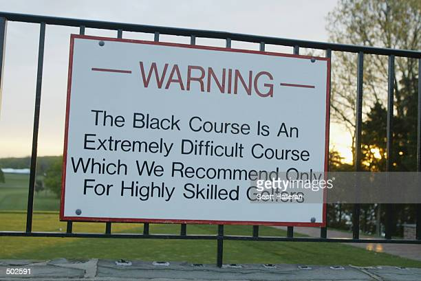 A warning sign greets golfers on the first tee at the Bethpage State Park Black course that will host the 2002 US Open this summer in Farmingdale New...