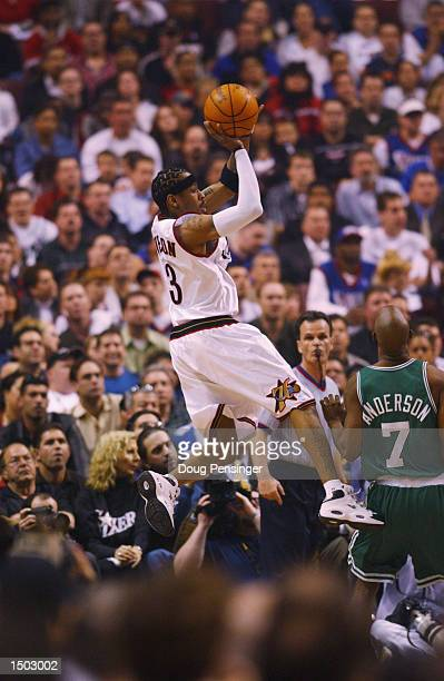 Allen Iverson of the Philadelphia 76ers looks to dish off a pass around Kenny Anderson of the Boston Celtics during game action in game four of round...