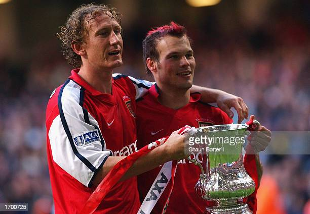 Arsenal's two goalscorers Ray Parlour and Fredrik Ljungberg lift the cup after the AXA sponsored FA Cup Final between Arsenal and Chelsea played at...