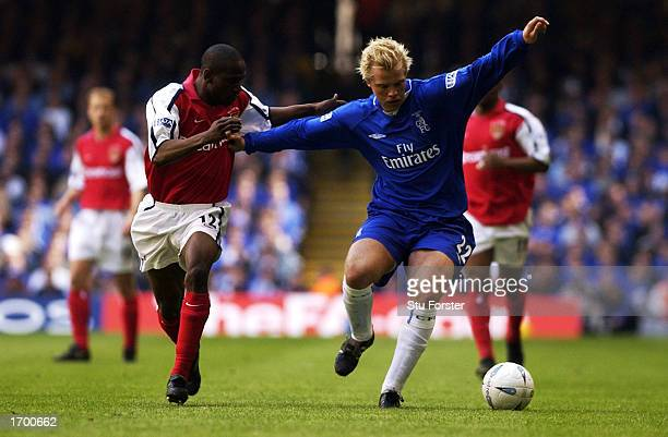 Eidur Gudjohnsen of Chelsea shields the ball from Lauren of Arsenal during the AXA sponsored FA Cup Final match played at the Millennium Stadium in...