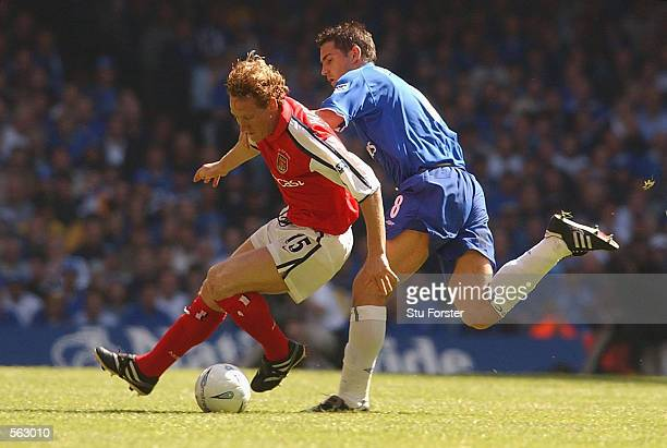 Frank Lampard of Chelsea tries to tackle Ray Parlour of Arsenal the AXA sponsored FA Cup Final between Arsenal and Chelsea at the Millennium Stadium...
