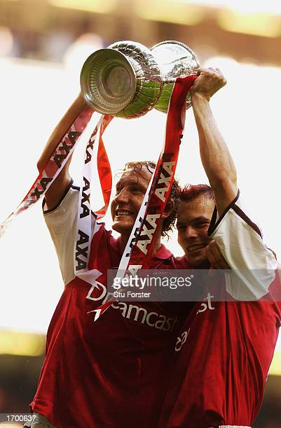 Goalscorers Ray Parlour and Fredrik Ljungberg of Arsenal celebrate winning the cup after the AXA sponsored FA Cup Final match between Arsenal and...