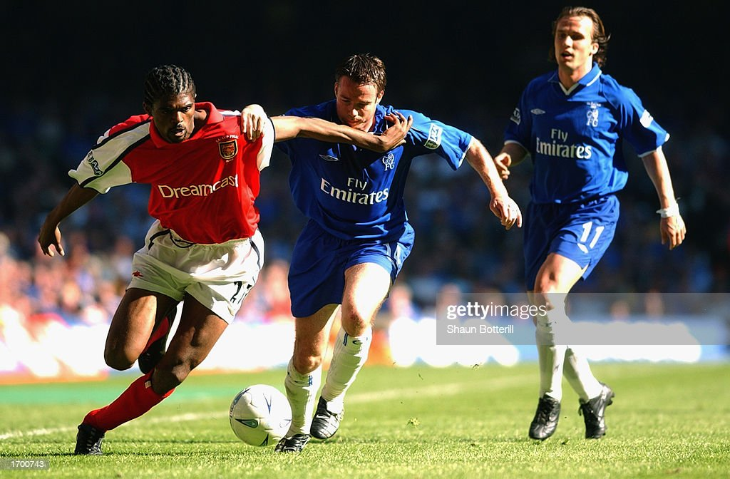 Nwankwo Kanu of Arsenal uses his strength as he takes the ball past Graeme Le Saux of Chelsea during the AXA sponsored FA Cup Final played at the Millennium Stadium, in Cardiff, Wales. Arsenal won the match and cup 2-0. DIGITAL
