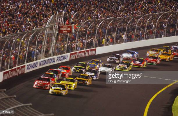 The field gets the green flag after a delayed start due to rain at the NASCAR Winston Cup Pontiac Excitement 400 at Richmond International Raceway in...
