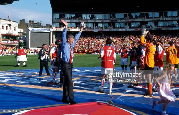 15 May 2004 Premiership Football Arsenal v Leicester City Arsenal manager Arsene Wenger raises his arms in celebration in the centre of the pitch