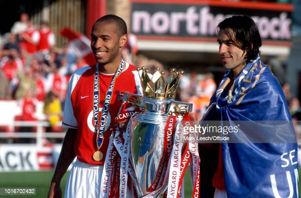 15 May 2004 Premiership Football Arsenal v Leicester City Thierry Henry and Robert Pires of Arsenal pose with the Premiership trophy