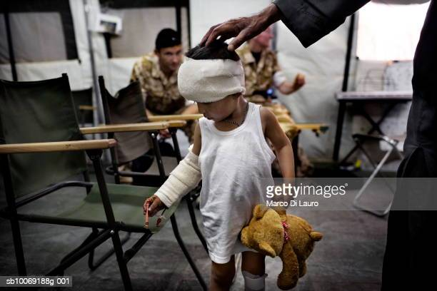 5 May 2007 An injured Afghan child is seen at the welfare department of the British Army Field Hospital at Camp Bastion located in the desert in...