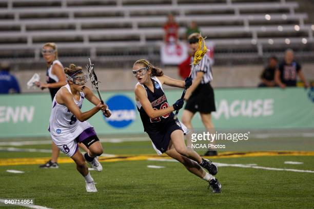 Emma Spiro of the University of Pennsylvania tries to maneuver around Ali Jacobs of Northwestern University during the Division I Womens Lacrosse...