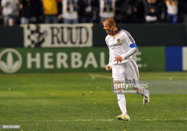 Galaxy David Beckham celebrates after scoring an open end goal in stoppage time during a Major League Soccer match between the Kansas City Wizards...