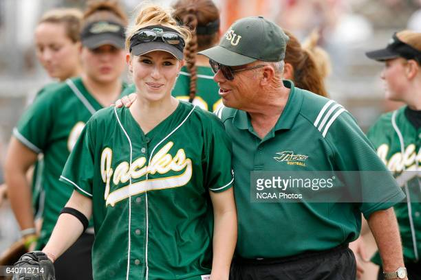 Humboldt State outfielder Chrissy Motzny is congratulated by Head Coach Frank Cheek after making a diving catch to end the inning during the 2008...