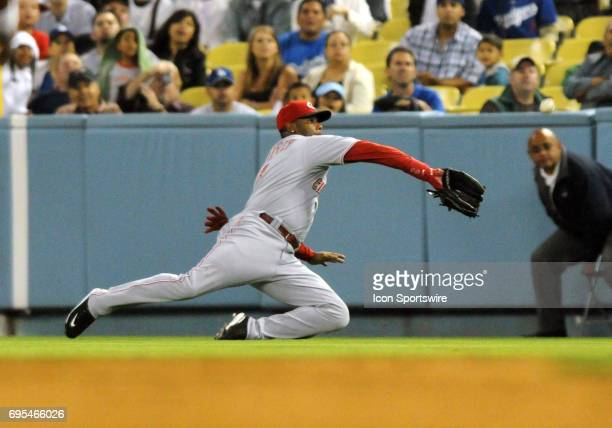 Reds Ken Griffey Jr makes a diving catch during a Major League Baseball game between the Los Angeles Dodgers and the Cincinnati Reds played at Dodger...