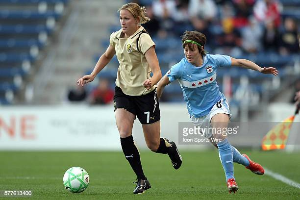 Chicago Red Stars midfielder Megan Rapinoe chases FC Gold Pride midfielder Leigh Ann Robinson for the ball California FC Gold Pride beat the Chicago...