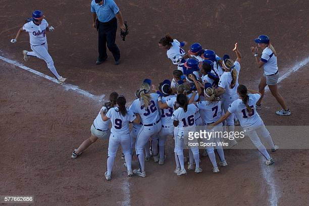 Florida players celebrate after Ali Gardiner hit a walk off grand slam to win the game during the NCAA Women's College World Series as the University...