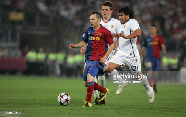 27 May 2009 Rome UEFA Champions League Final FC Barcelona v Manchester United Andres Inesta of Barcelona is challenged by Carlos Tevez of United