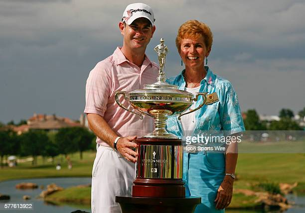 Rory Sabbatini and Peggy Nelson the wife of the late Byron Nelson pose for photographs with the championship trophy Sabbatini won the HP Byron Nelson...