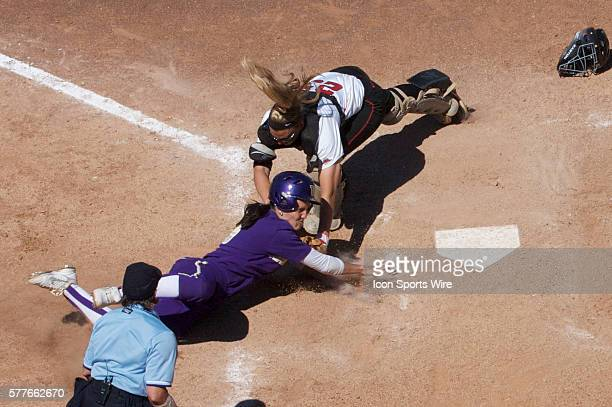 Washington Husky utility player Amanda Fleischman is tagged out by Georgia catcher Kristyn Sandberg before she could reach home plate during the NCAA...