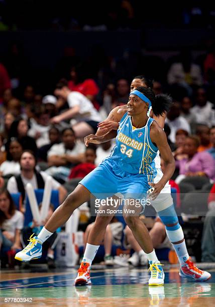 Sky's center Sylvia Fowles tries to get low post position on Liberty's center Kia Vaughn during WNBA action between the New York Liberty and the...