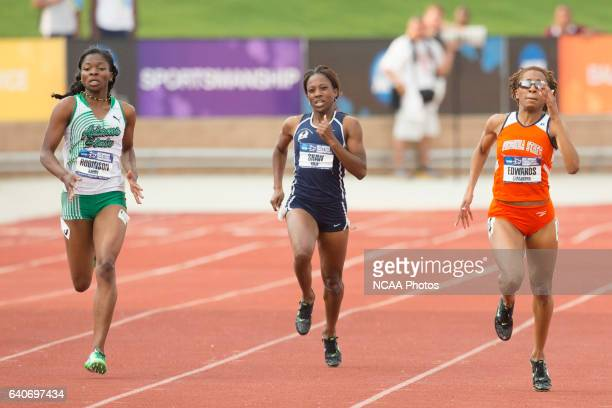 Kayon Robinson of Adams State University closes in Samantha Edwards of Virginia State University in the Women's 400 Meter Dash during the NCAA...