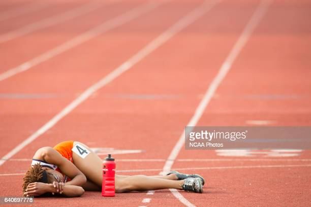 Samantha Edwards of Virginia State University lays on the ground in exhaistion after competing in the Women's 400 Meter Dash during the NCAA Division...