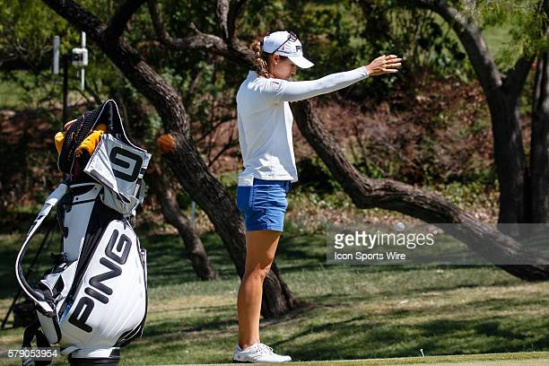 Azahara Munoz of Spain takes relief from a sprinkler head on during the third round of the North Texas LPGA Shootout played at the Las Colinas...