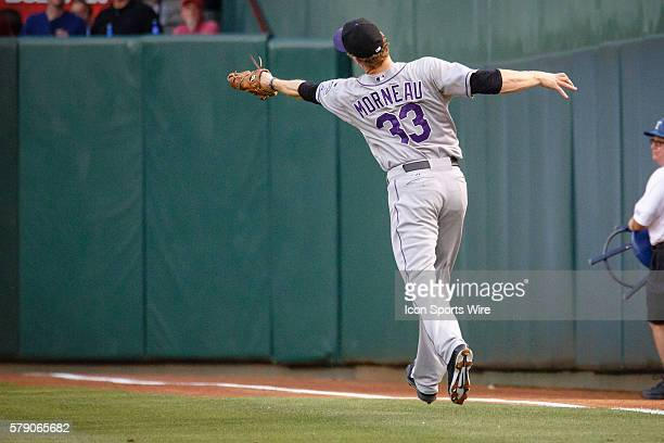 Colorado Rockies first baseman Justin Morneau stretches to run down a fly ball in shallow right field during the MLB baseball game between the Texas...