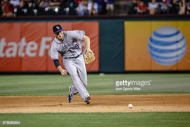 Colorado Rockies second baseman DJ LeMahieu makes a bare handed play on a ground ball during the MLB baseball game between the Texas Rangers and...