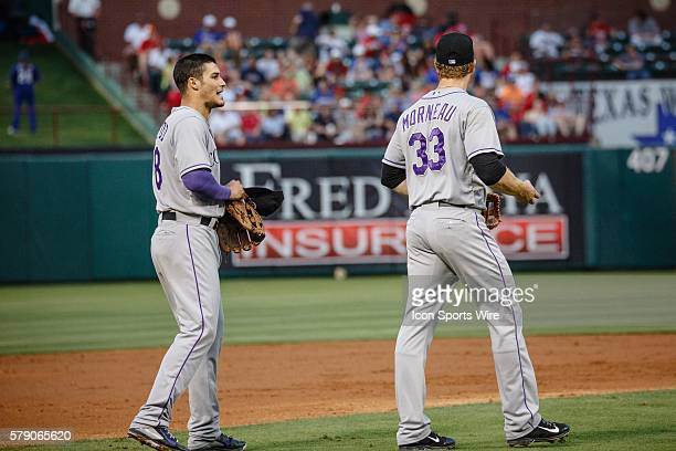 Colorado Rockies third baseman Nolan Arenado talks to first baseman Justin Morneau after getting caught in a run down between 3rd base and home plate...