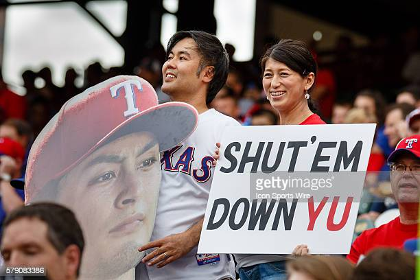 Fans are out early to support their team during the MLB baseball game between the Texas Rangers and Boston Red Sox at the Globe Life Park in...