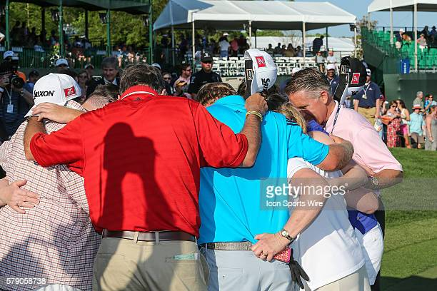 J B Holmes and his family take a moment in prayer after his win during third round action at the the Wells Fargo Championship Tournament at Quail...